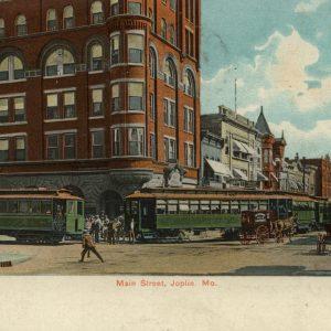Trolley Cars, or streetcars, pass in front of the Keystone Hotel in Joplin, Missouri.
