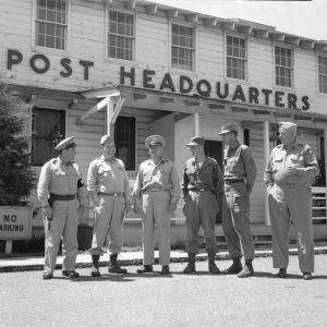 Pictured from left to right are Clifford Martin, Capt. Carl F. Oran, Capt. Lewis F. Childress, Lt. Jack Morris, Lt. Royal D. Jeter, and Capt. O.P. Armstrong. They are standing in front of the post headquarters at Fort Leonard Wood. Published in the News & Leader on August 6, 1950.