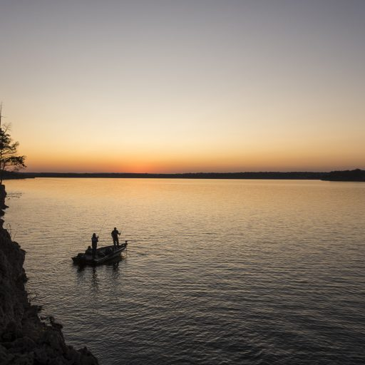 People fishing off Indian Point at Pomme de Terre State Park at Sunset, 2020